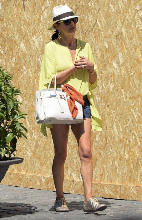 Catherine Zeta-Jones in shorts out in Palma de Mallorca in June 2015