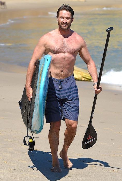 Gerard Butler shirtless at a beach in Malibu