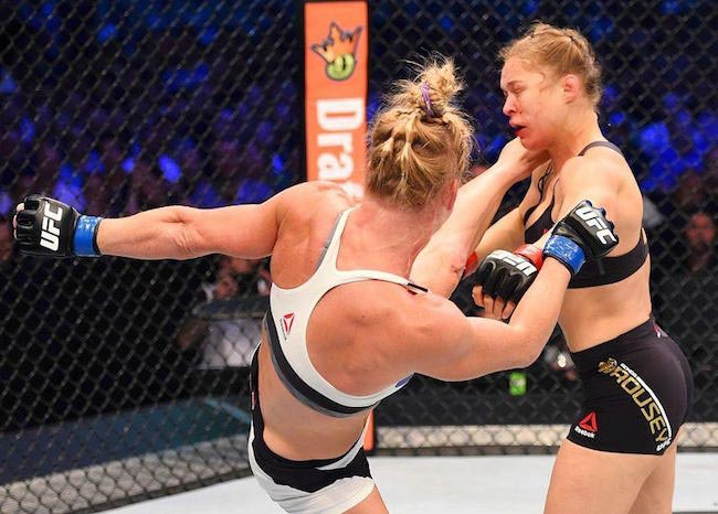 Holly Holm landing a high kick on Ronda Rousey during their match in November 2015