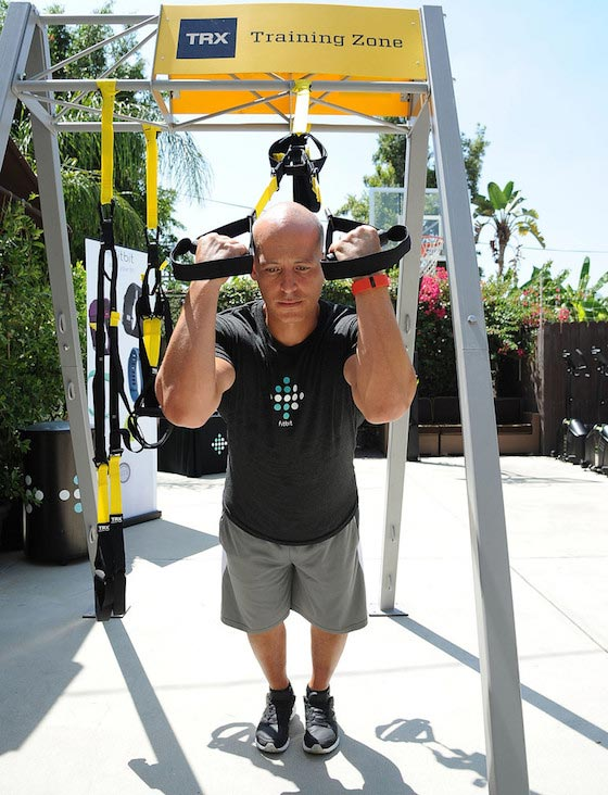 Celebrity trainer, Harley Pasternak leads a group workout using Fitbit Charge HR on August 18, 2015 in Los Angeles, California