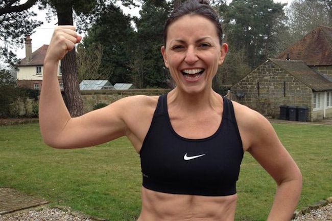Davina McCall showing her muscle