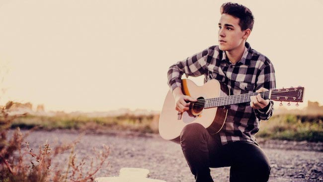 Jacob Whitesides playing guitar