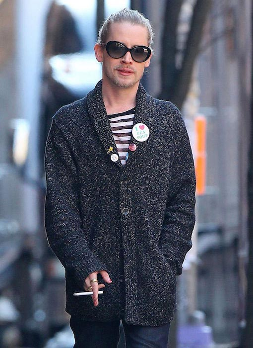 Macaulay Culkin enjoying a cigarette while roaming solo in New York City