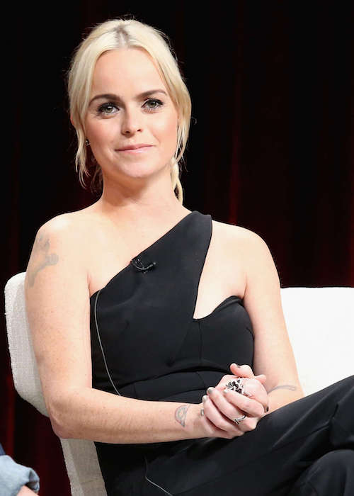 "Taryn Manning sitting within ""Orange Is the New Black"" Panel in July 2015"
