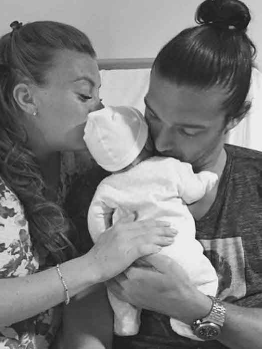 Billi Mucklow and Andy Carroll with son