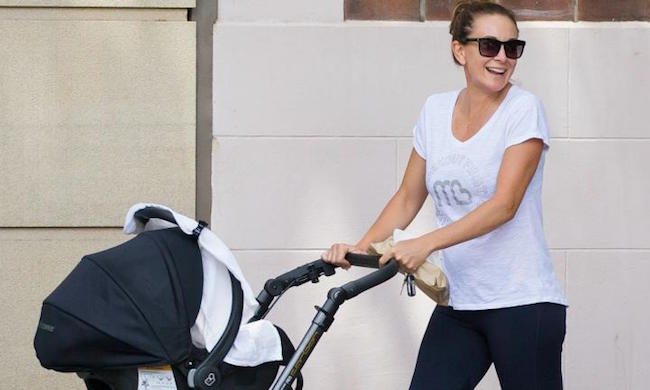 Michelle Bridges walking her son