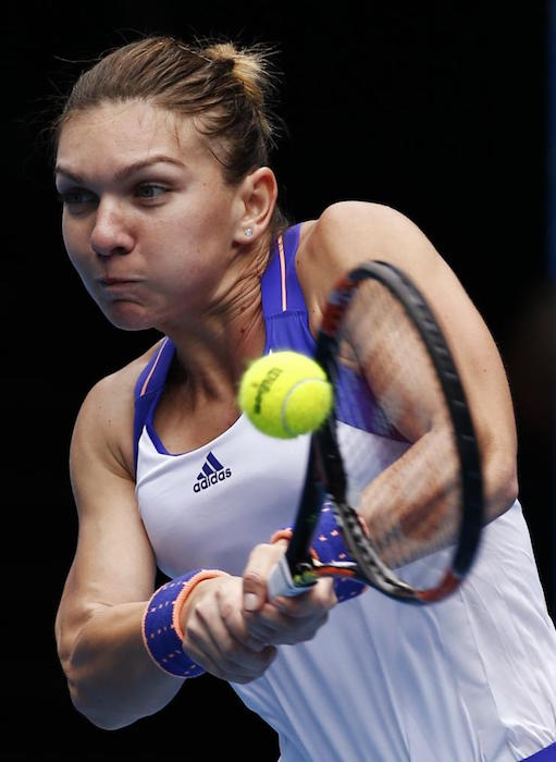 Simona Halep playing a shot in a match