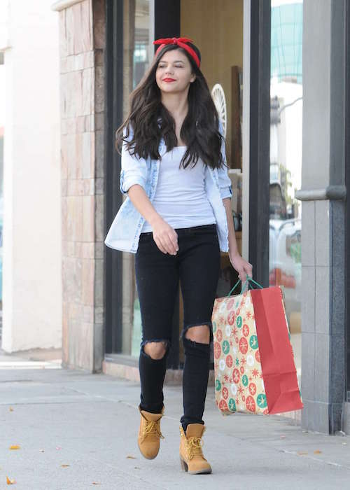 Amber Montana in ripped jeans during a Christmas shopping in December 2015