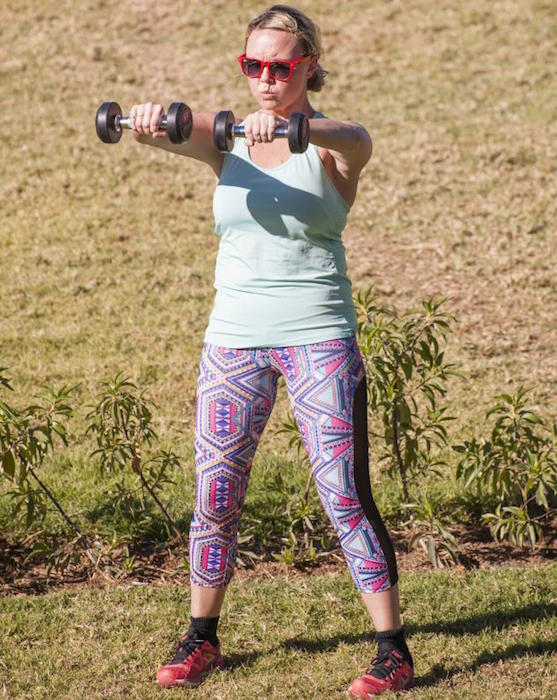 Charlie Brooks doing dumbbell workout during bootcamp