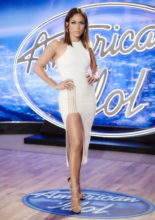Jennifer Lopez wears David Koma Resort 2016 Ivory High Slit Dress and Casadei Sandals to American Idol in October 2015