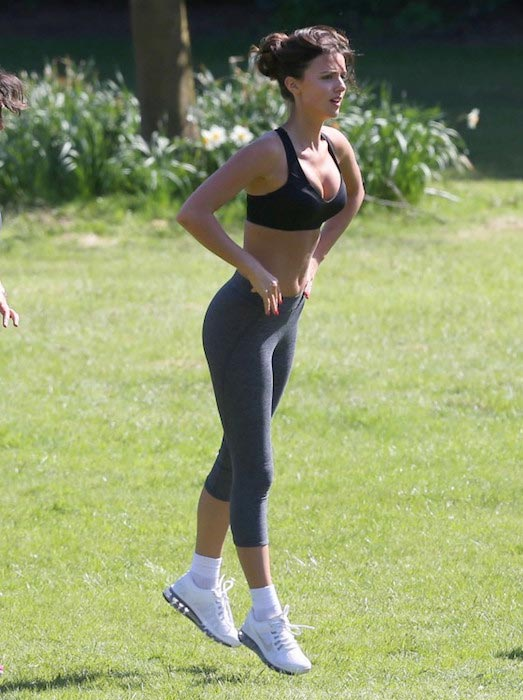 Lucy Mecklenburgh doing a workout in a London park