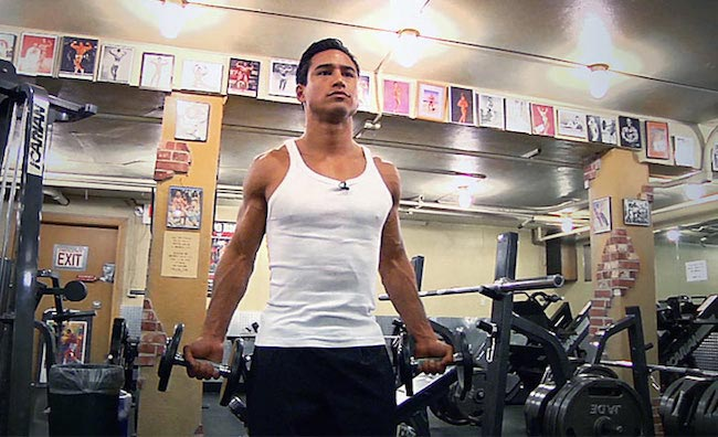 Mario Lopez doing bicep curls