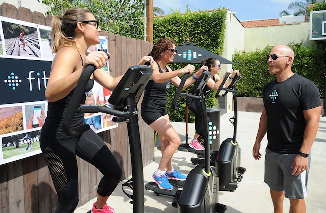 Celebrity trainer Harley Pasternak lead a group workout using Fitbit Charge HR