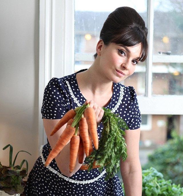 Gizzi Erskine holding carrots