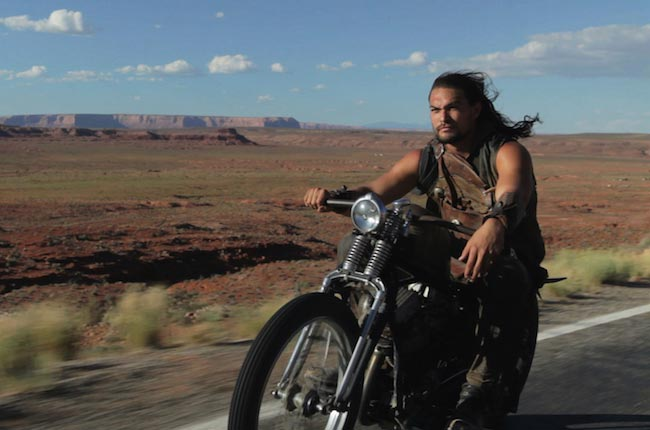 Jason Momoa riding a motorcycle