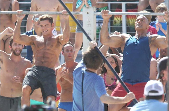 Zac Efron and The Rock during a pull-up contest