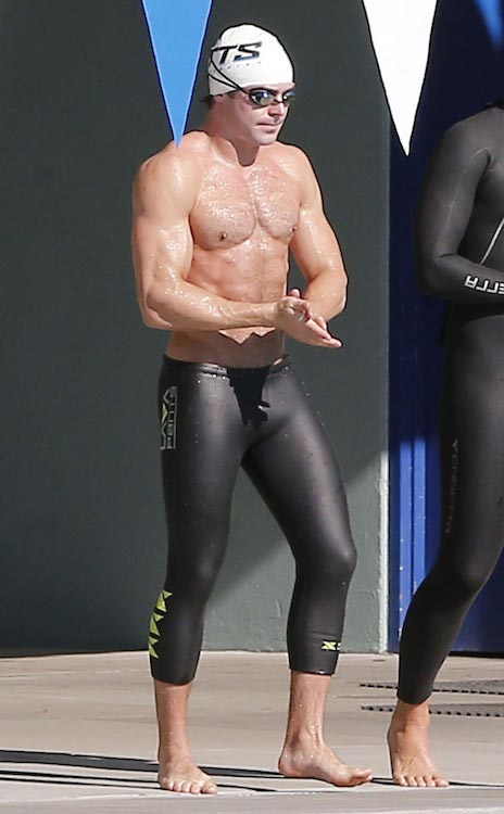 Zac Efron showcases his chiseled chest during a swimming lesson for Baywatch role