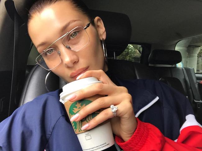 Bella Hadid in a car selfie in October 2017 having Starbucks coffee