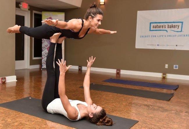 Danica Patrick gets an assist from yoga expert Morgan DeYoung