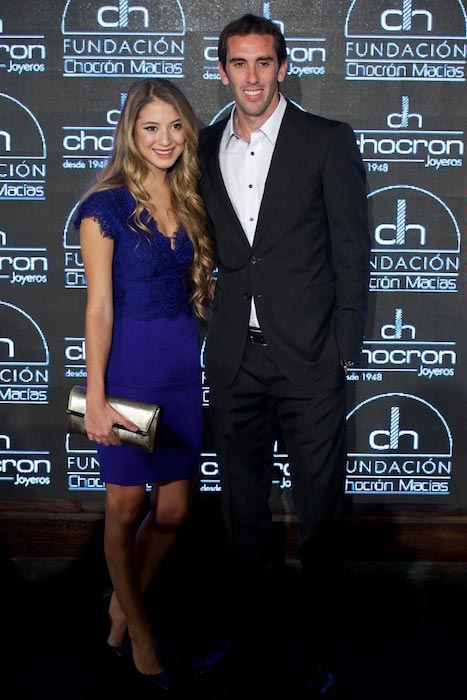 Diego Godin and Sofia during a presentation of Chocron Jewelry Charity Catalogue on December 1, 2014