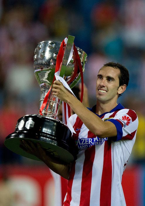 Diego Godin celebrates after winning La Liga Cup trophy after a match against SD Eibar on August 30, 2014