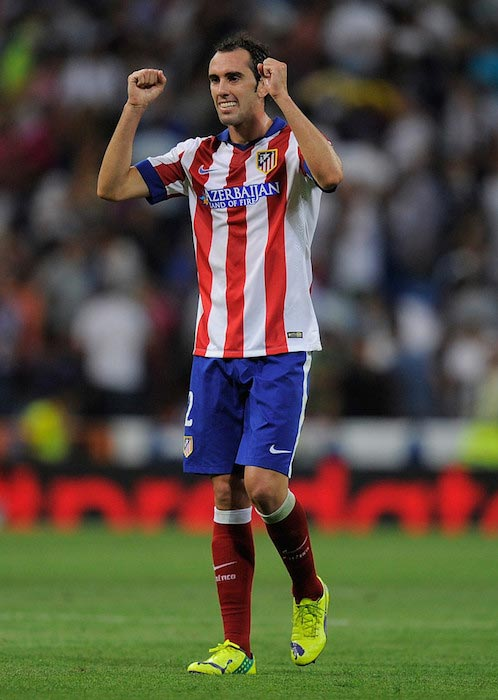 Diego Godin celebrates his team's victory against Real Madrid on September 13, 2014
