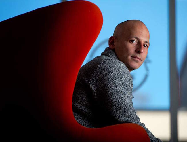 Harley Pasternak sitting on the couch