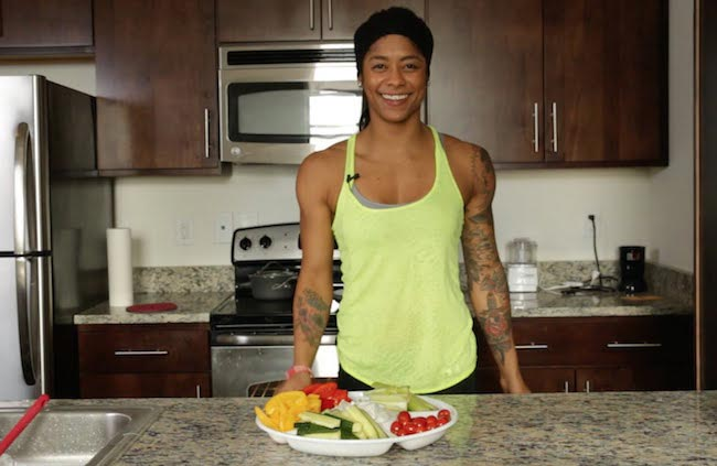 Massy Arias in kitchen having food