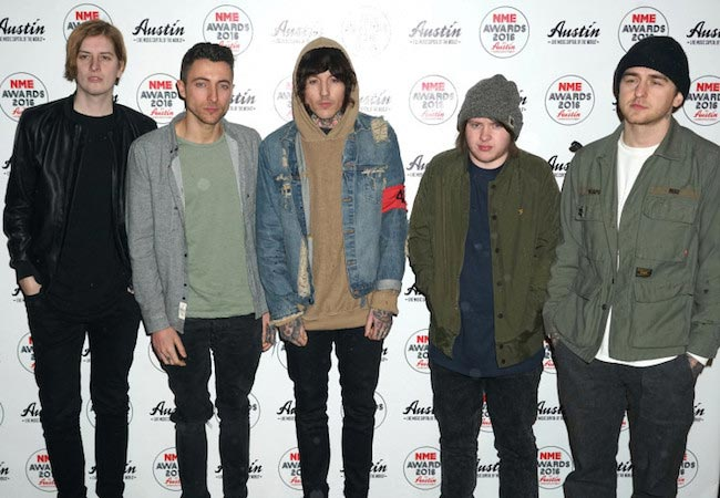 "Oliver Sykes with his ""Bring Me The Horizon"" bandmates"