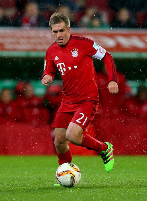 Philipp Lahm handles the ball during a match between Bayern Munich and FC Augsburg on February 14, 2016 in Augsburg, Germany