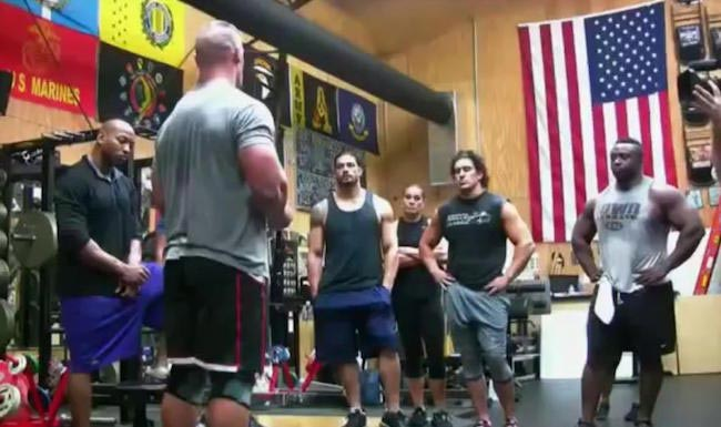 Roman Reigns training in the gym with John Cena