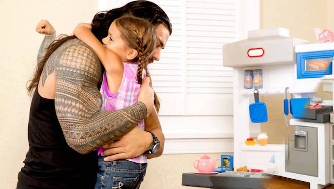 Roman Reigns with his daughter