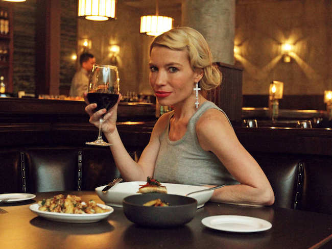 Tracy Anderson enjoying food with a drink