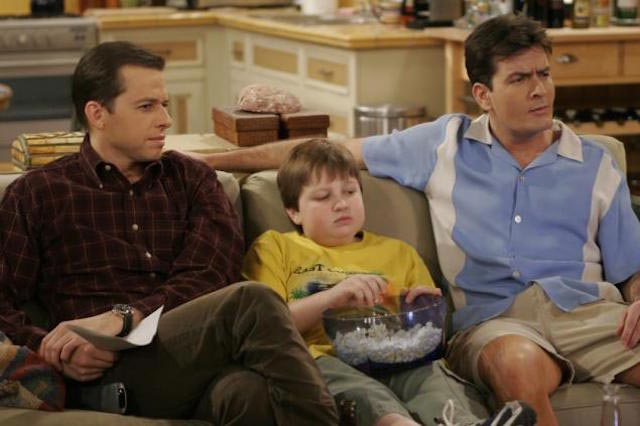 "Angus T. Jones (Center) in a still from ""Two and a Half Men"""