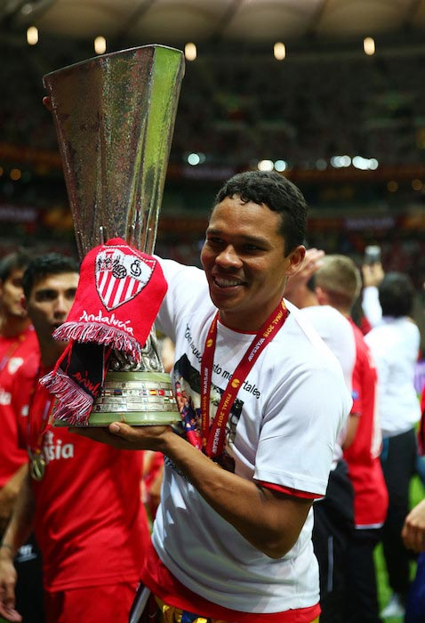 Carlos Bacca with the trophy after his team FC Sevilla won the UEFA Europa League Final match against FC Dnipro on May 27, 2015