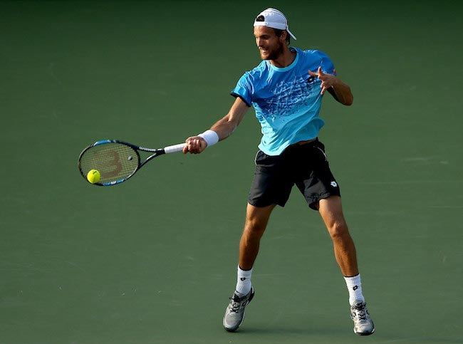 Joao Sousa during a match against Novak Djokovic at Miami Open on March 27, 2016 in Key Biscayne, Florida