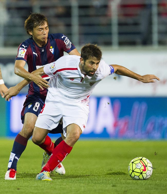 Jorge Andujar Moreno in a duel with Takashi Inui of Eibar in a match between Sevilla FC and SD Eibar on October 17, 2015