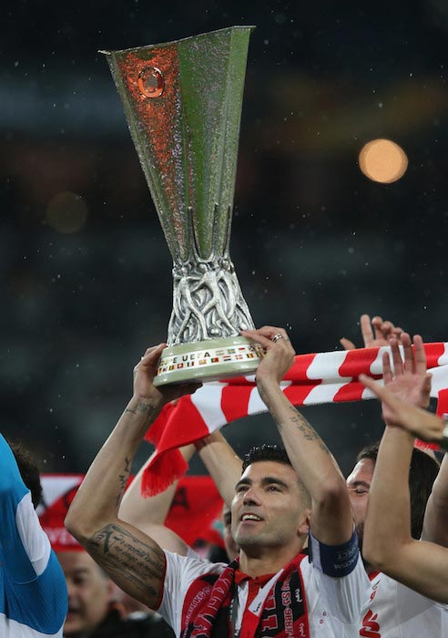 Jose Antonio Reyes with the trophy after winning the 2016 UEFA Europa League with Sevilla FC on May 18, 2016