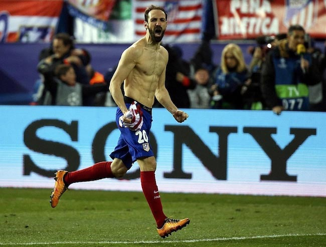 Juanfran celebrates after scoring a goal for his team during a Primera Division match.