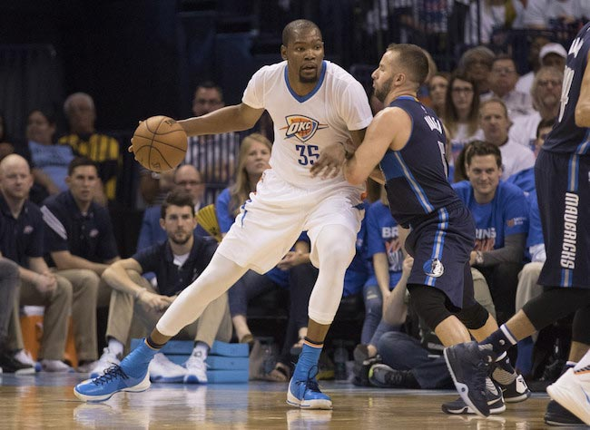 Kevin Durant in a duel with J.J. Barea from Dallas Mavericks in a game one of the Western Conference Quarterfinals of the 2016 NBA Playoff on April 16, 2016