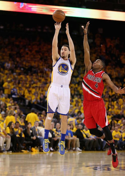 Klay Thompson shooting over Maurice Harkless in a match of the Western Conference Semifinals between Golden State Warrior and Portland Trail Blazers at Oracle Arena in California on May 11, 2016