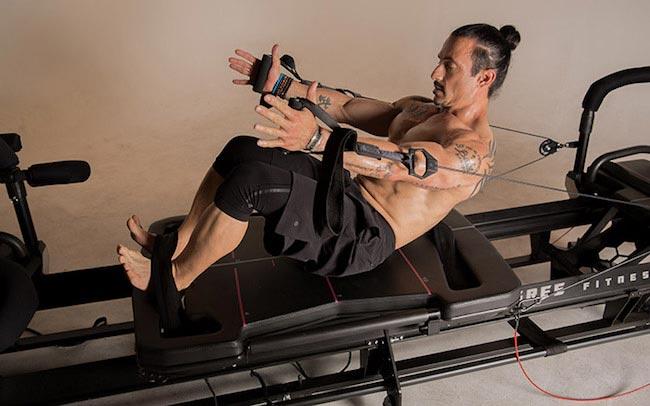 Ky Evans workout on Megaformer machine