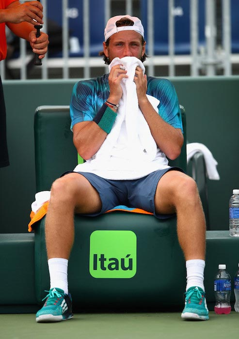 Lucas Pouille during a match against Gilles Simon at Miami Open on March 29, 2016 in Key Biscayne, Florida