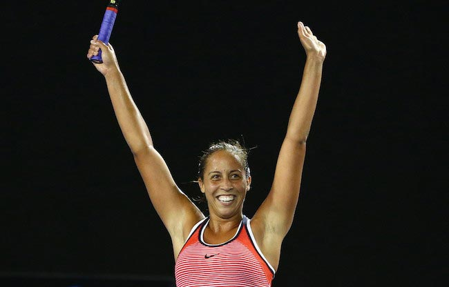 Madison Keys celebrates after winning her third round match against Ana Ivanovic at the 2016 Australian Open on January 23, 2016