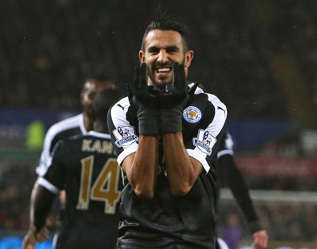 Riyad Mahrez celebrates his hat-trick in a Premier League match against Swansea on December 5, 2015