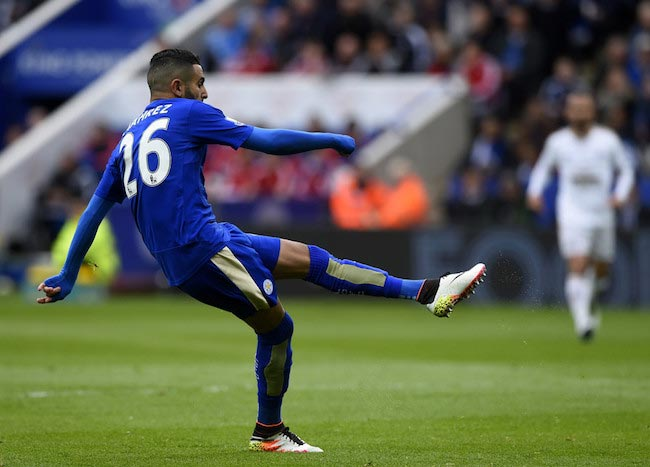 Riyad Mahrez scoring a goal in a match against Swansea City on April 24, 2016 in Leicester, United Kingdom