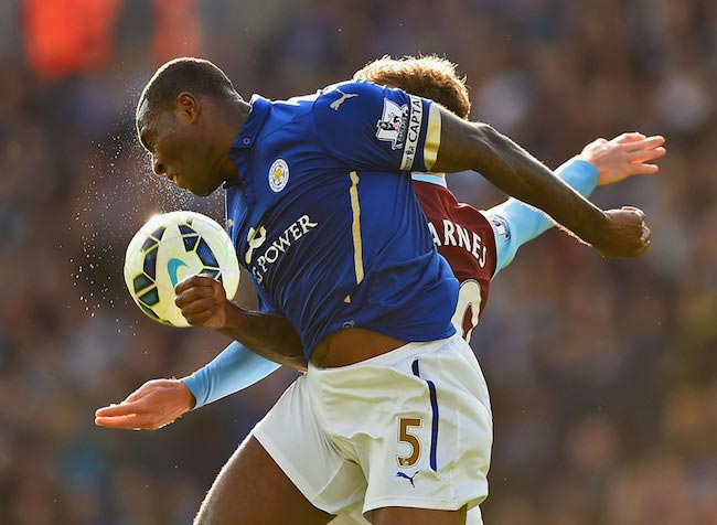 Wes Morgan in duel with Burnley's player Ashley Barnes in a league match between Leicester City and Burnley on October 4, 2014