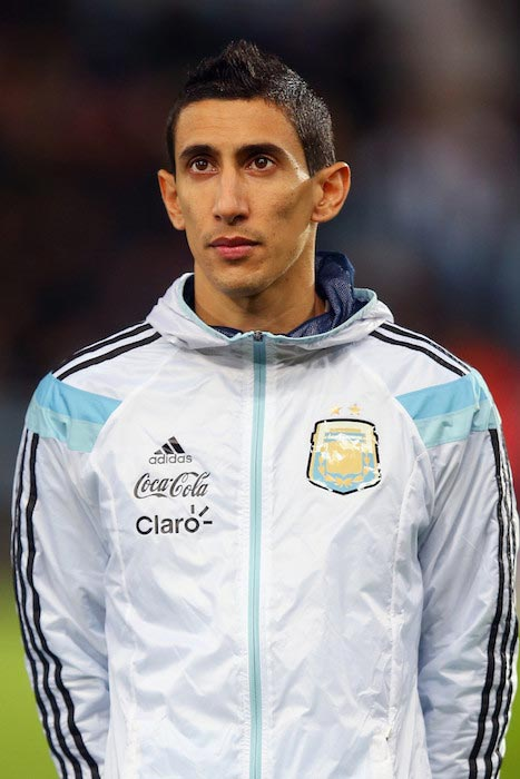 Angel Di Maria listens to his national team anthem before a friendly match between Argentina and Croatia on November 12, 2014