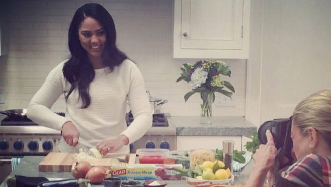 Ayesha Curry chopping vegetables in the kitchen