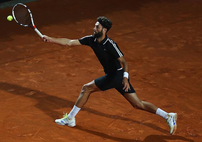 Benoit Paire returns the shot to Stan Wawrinka during a match of The Internazionali BNL d'Italia 2016 on May 10, 2016